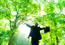 stock-photo-15246083-green-businessman-in-touch-with-nature